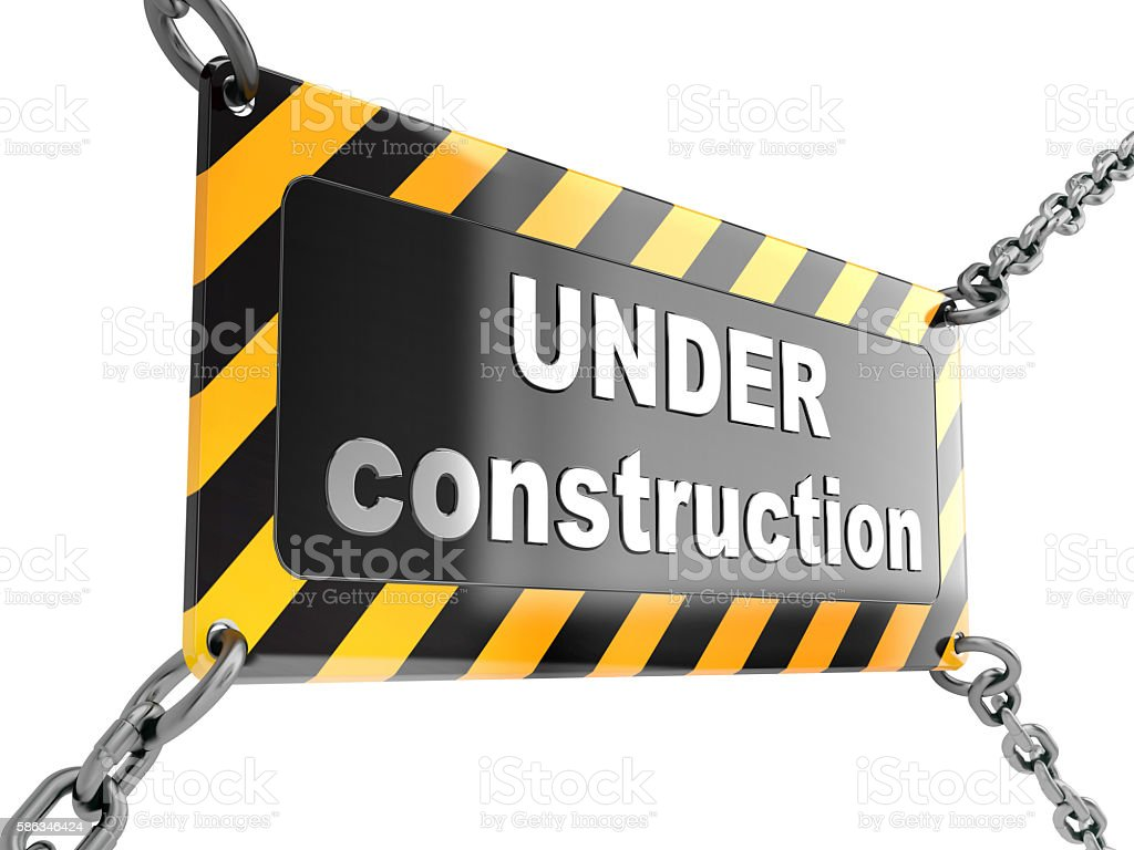under construction sign on chain stock photo