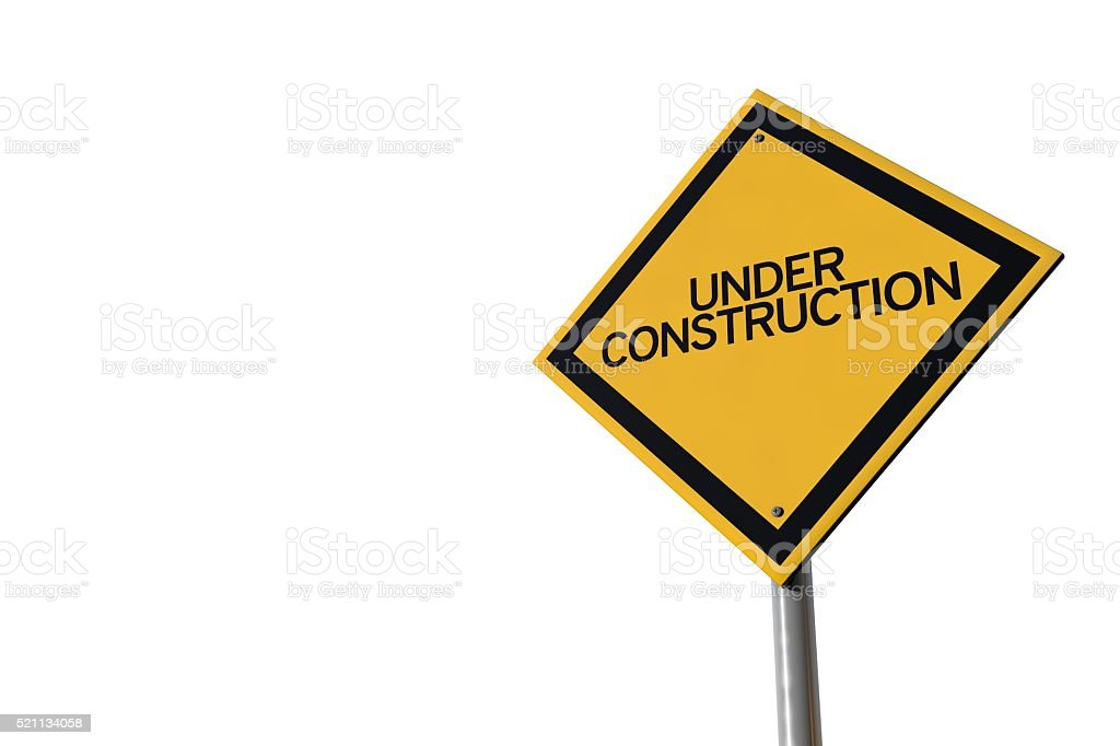 Under construction yellow highway road sign stock photo