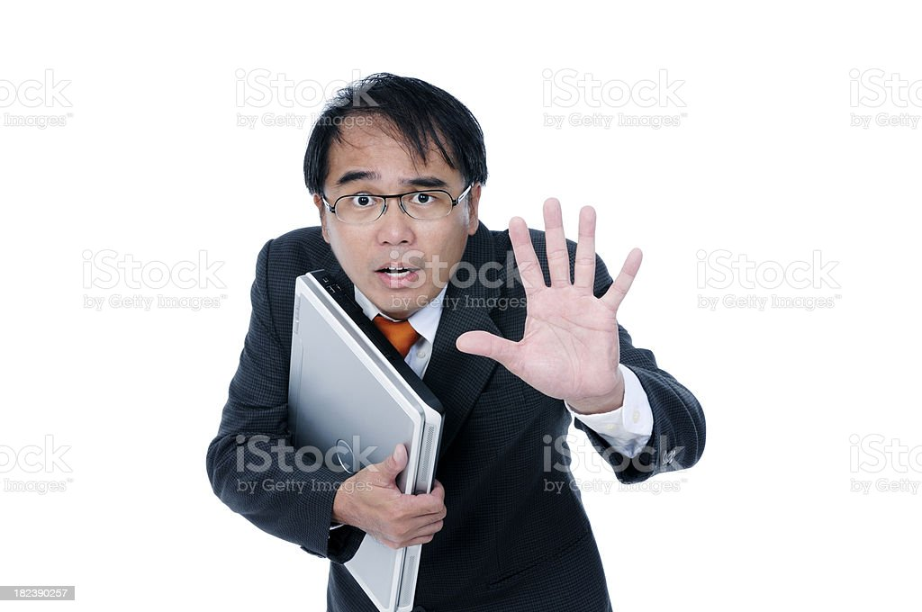 Under duress businessman holding a laptop royalty-free stock photo