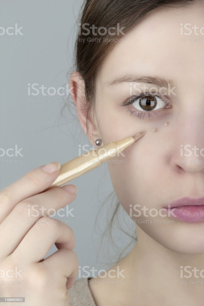 Under eye concealer stock photo