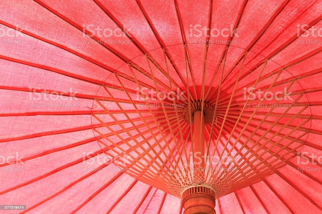 Under of a vintage red Thai umbrella stock photo