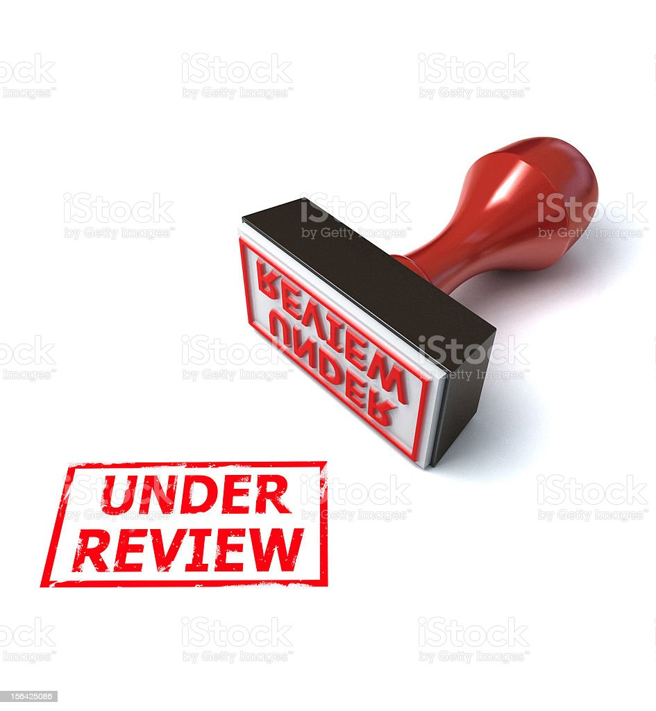 Under review rubber stamp on white background royalty-free stock photo