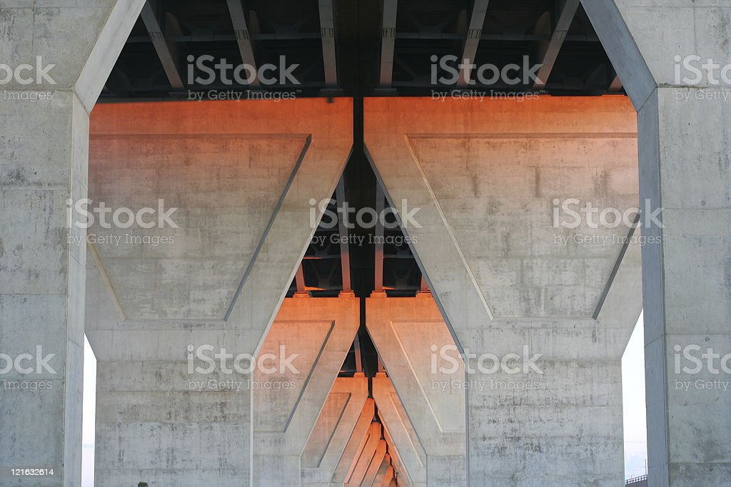 Under the bridge at sunset stock photo