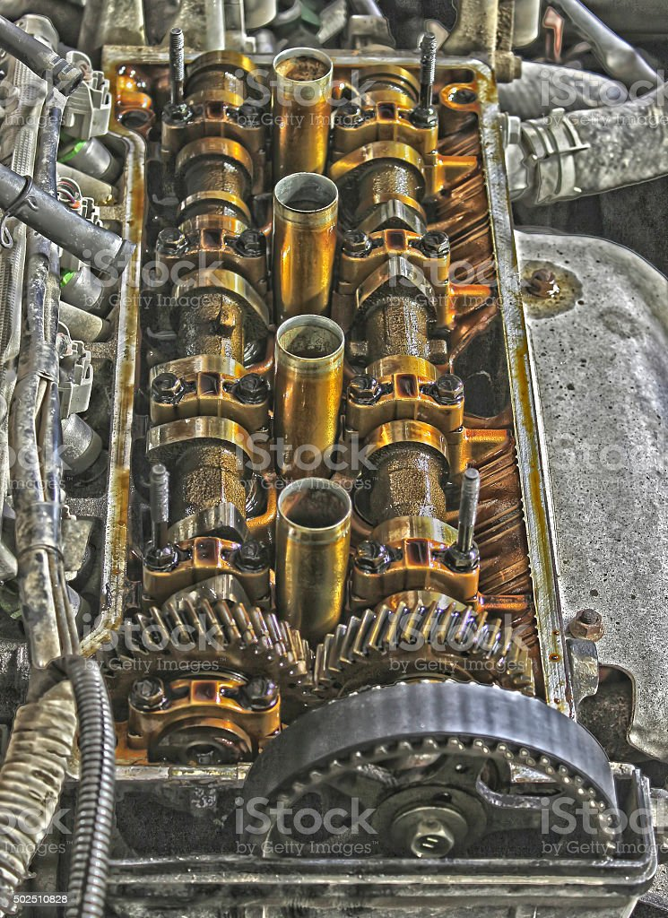Under the cover of the valves of the car stock photo