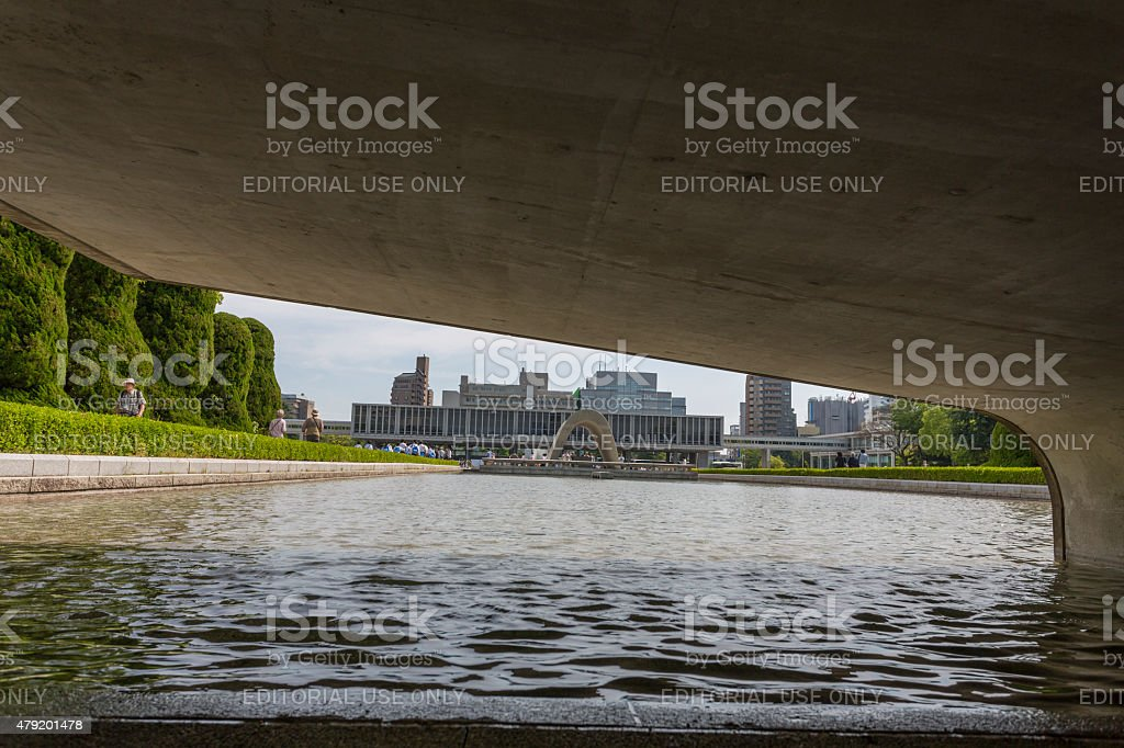 Under the Eternal Flame to Cenotaph in Hiroshima Peace Park stock photo