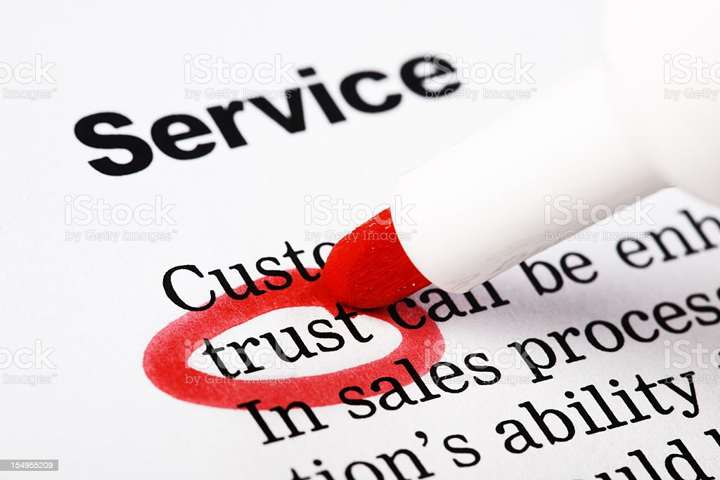 """Under the headline """"Service"""", """"trust"""" is highlighted on printed document royalty-free stock photo"""