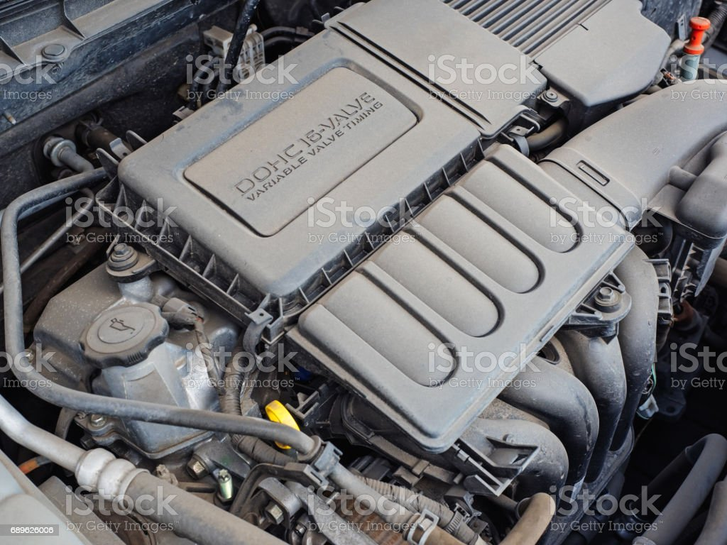 Under the hood: car engine in the dust stock photo