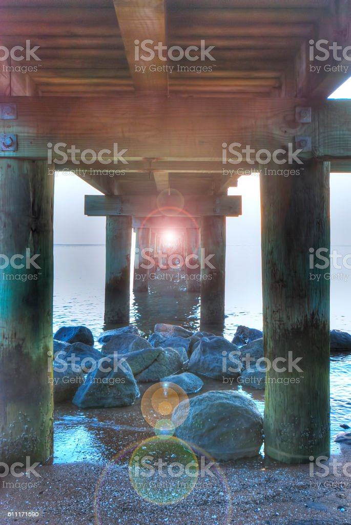 Under the pier with flare stock photo