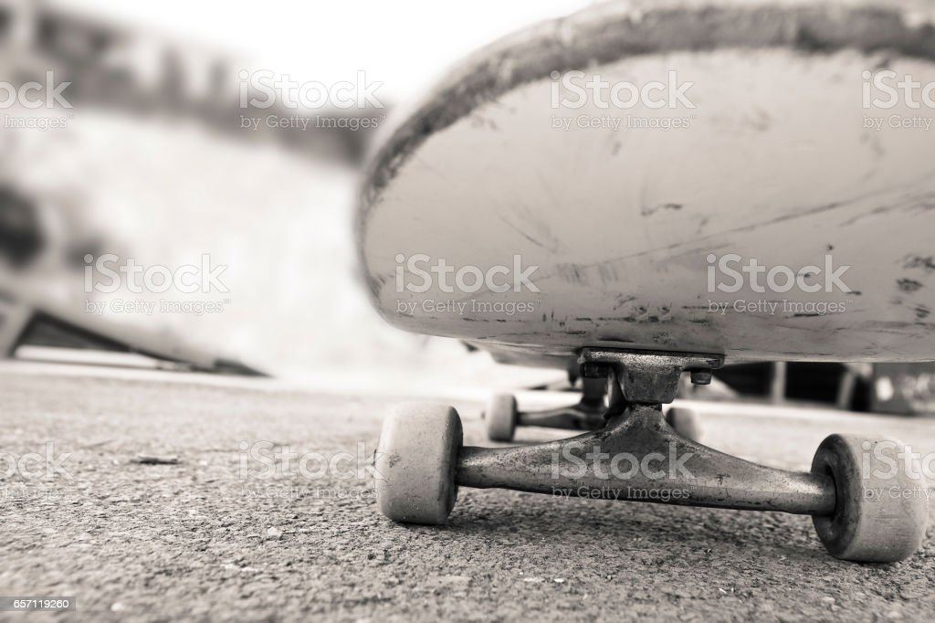 skateboard photographed from the front you can see wheels and the...