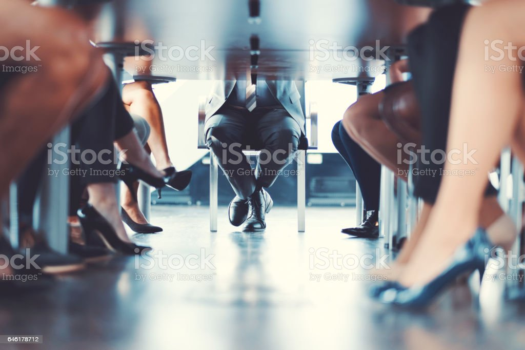 Under the table shot at business meeting stock photo