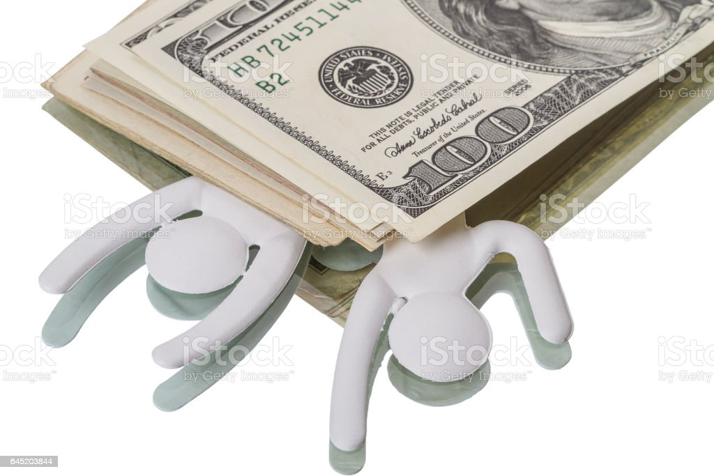 Under the weight of Dollars stock photo