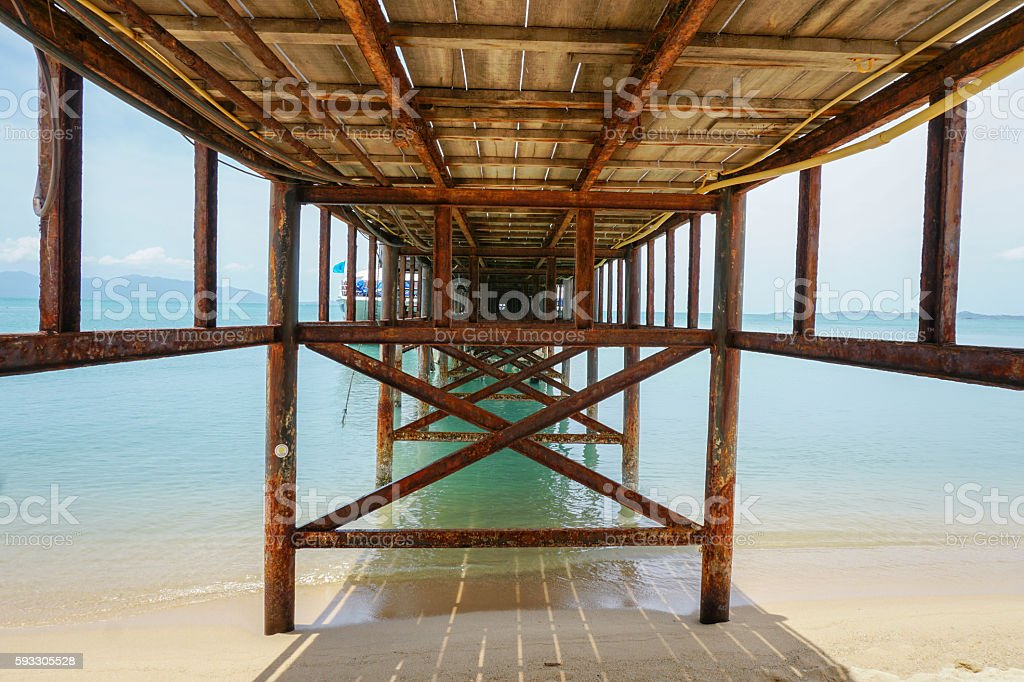 Under tropical pier stock photo