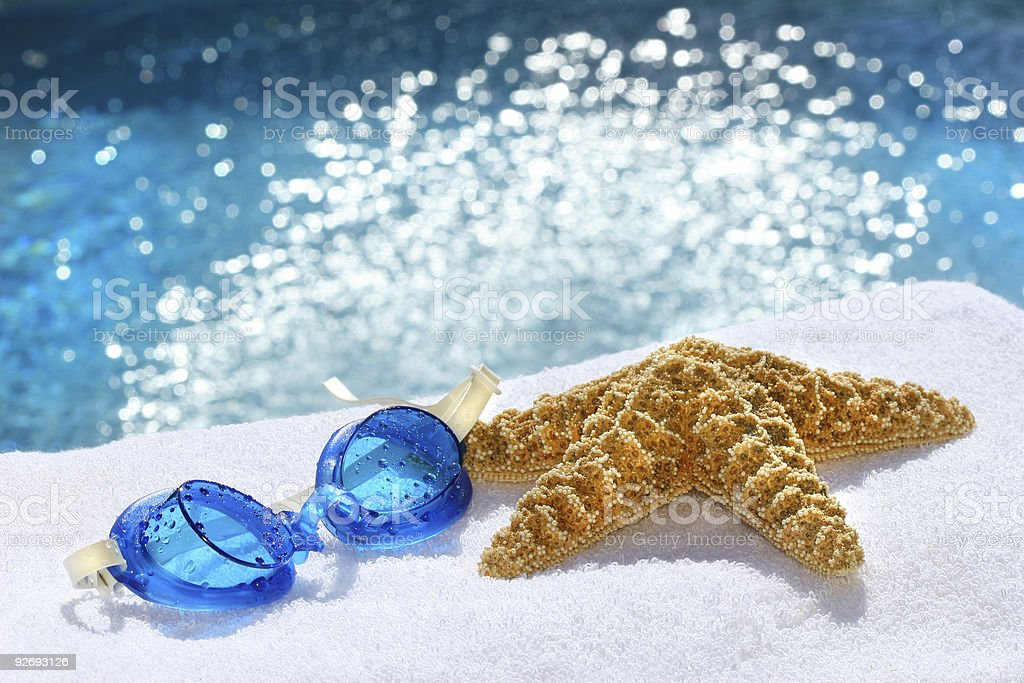 Under water goggles with starfish stock photo