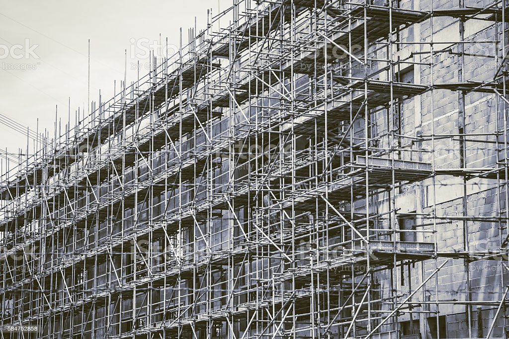 Underconstruction building, construction structure in vintage color tone. stock photo