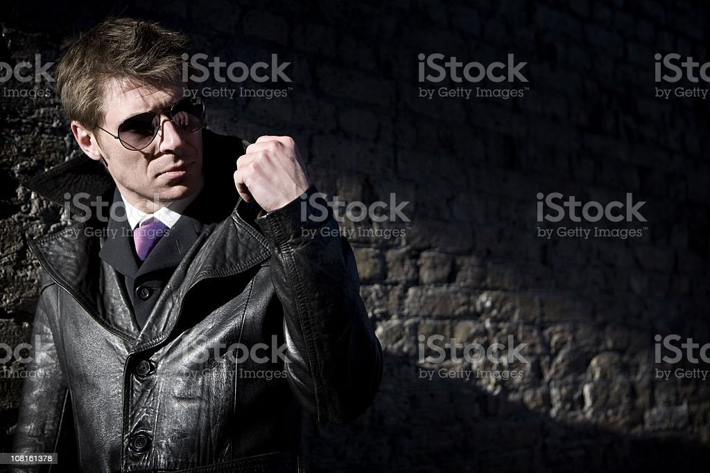 undercover agent hiding in the shadows royalty-free stock photo