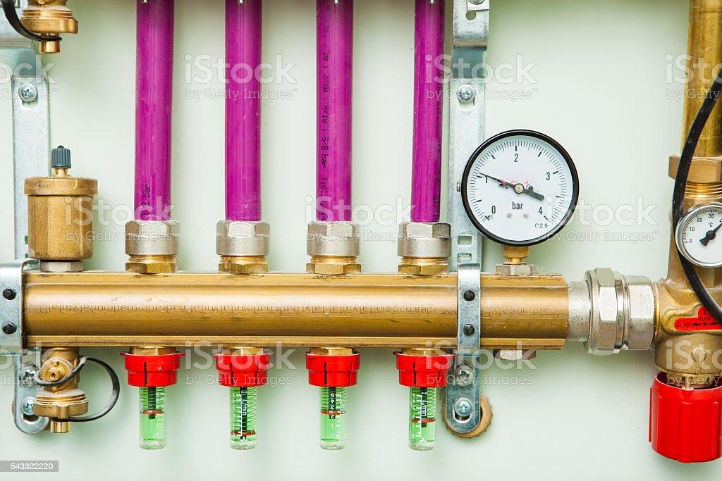underfloor heating control system in boiler-room stock photo