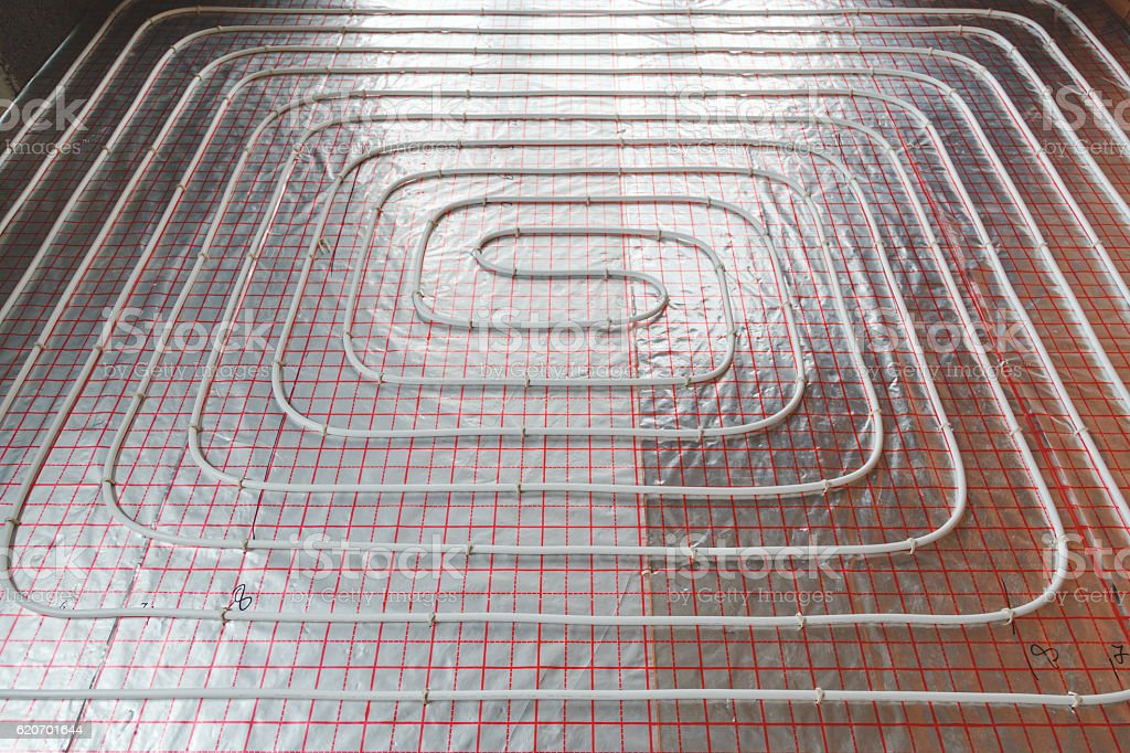Underfloor heating installation. Water floor heating system interior. plumbing pipes. Individual Heating. stock photo