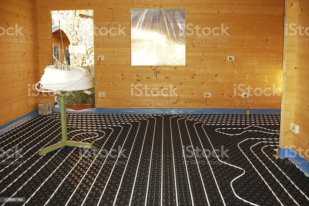 Underfloor Heating System in Wooden House stock photo