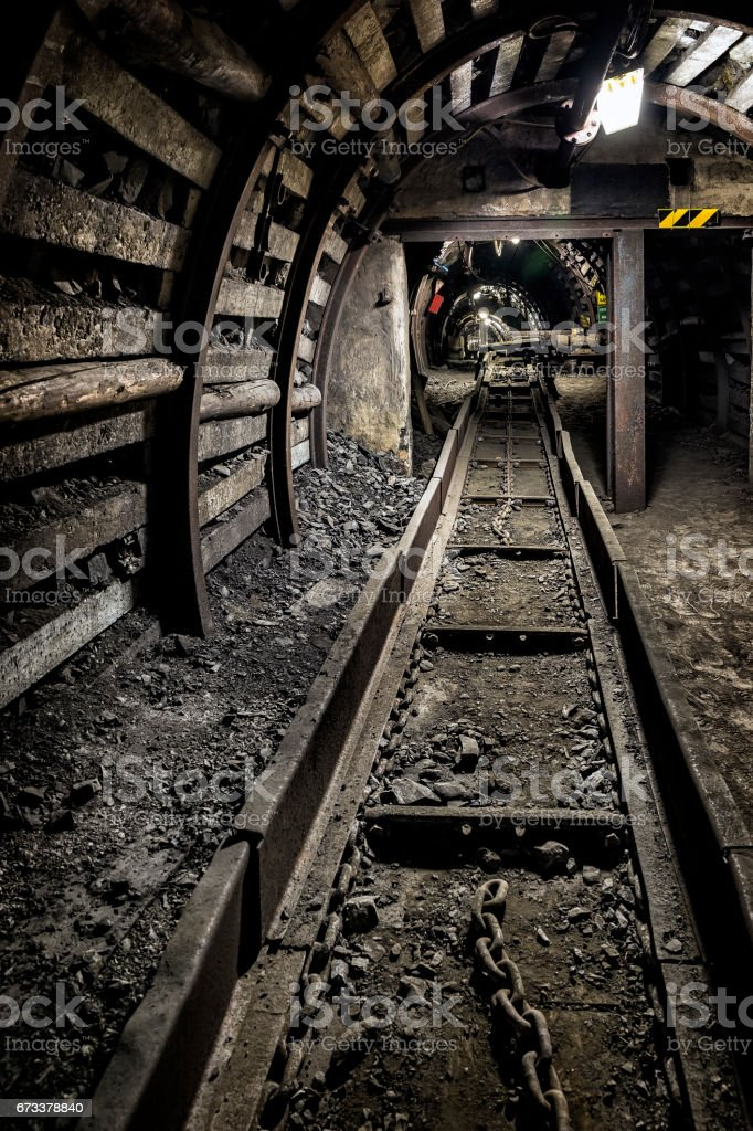 Underground corridor with steel support system and railroad truck