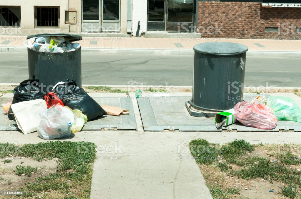 Underground dumpsters full of garbage. Litter. Garbage in the city. stock photo