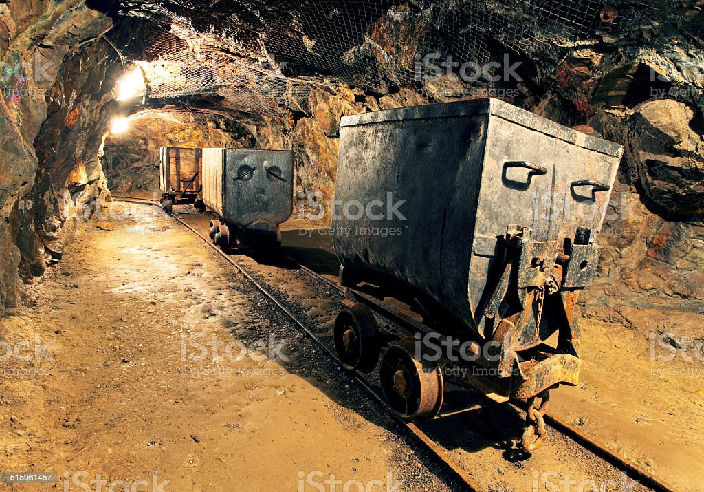 Underground mine tunnel, mining industry stock photo