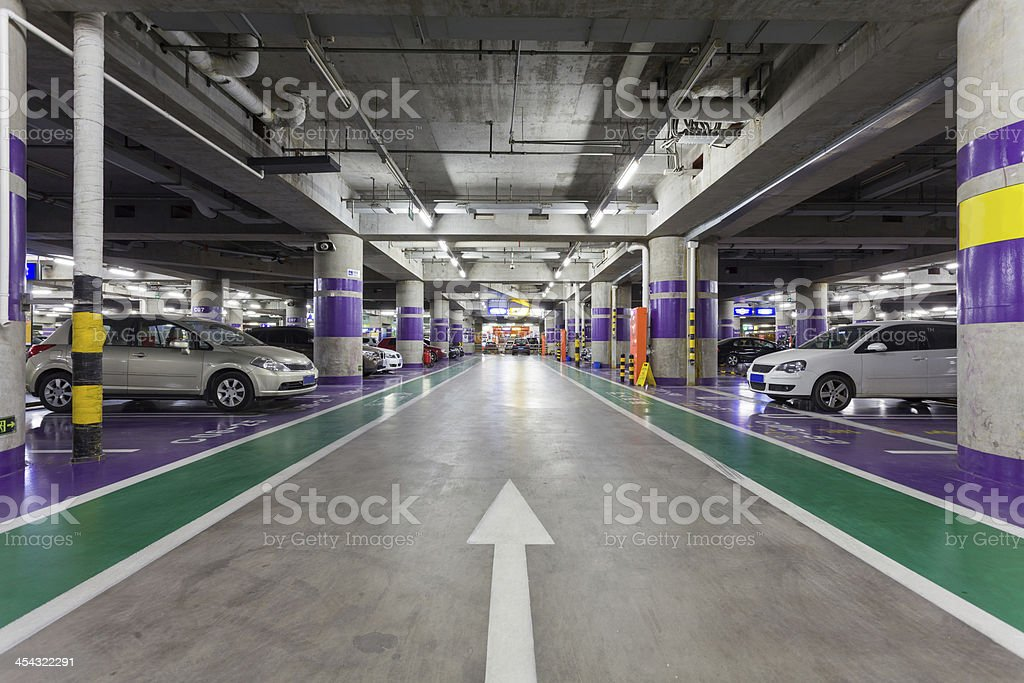 Underground parking aisle stock photo
