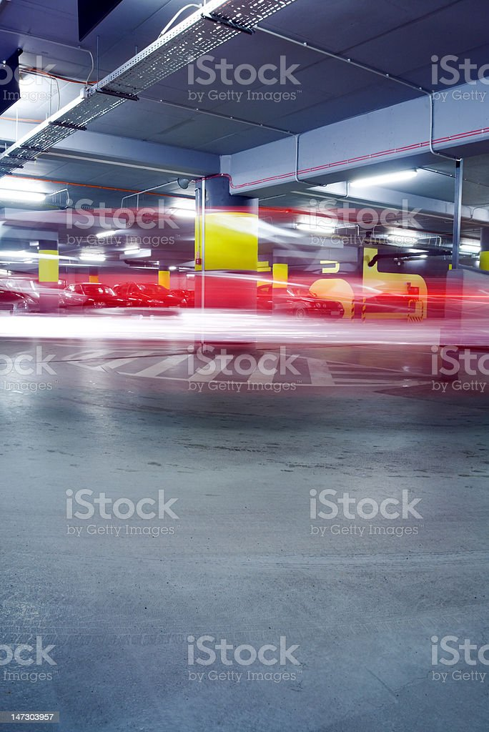 Underground parking garage with moving car royalty-free stock photo