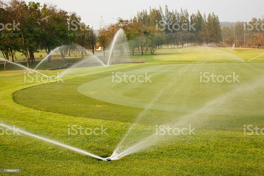 Underground pipers auto-watering in golf course stock photo
