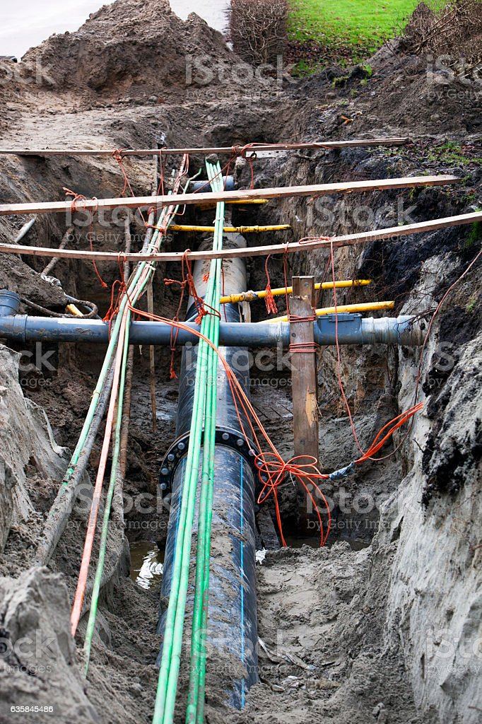 Underground pipes and cables stock photo
