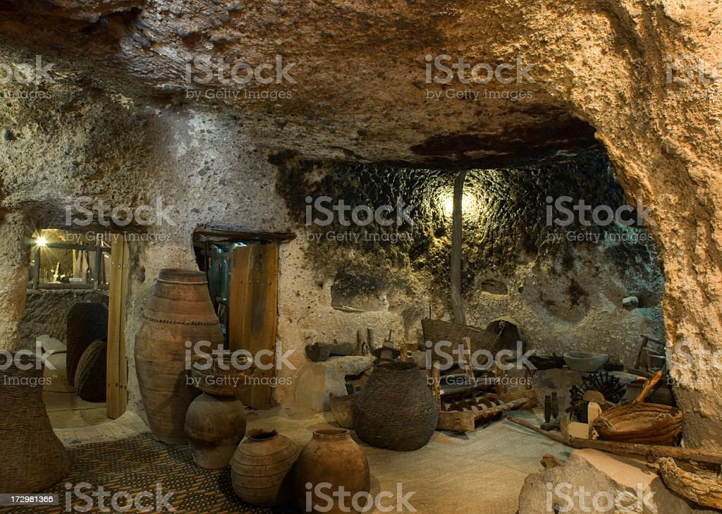 Underground room with ancient pottery at Maymand royalty-free stock photo