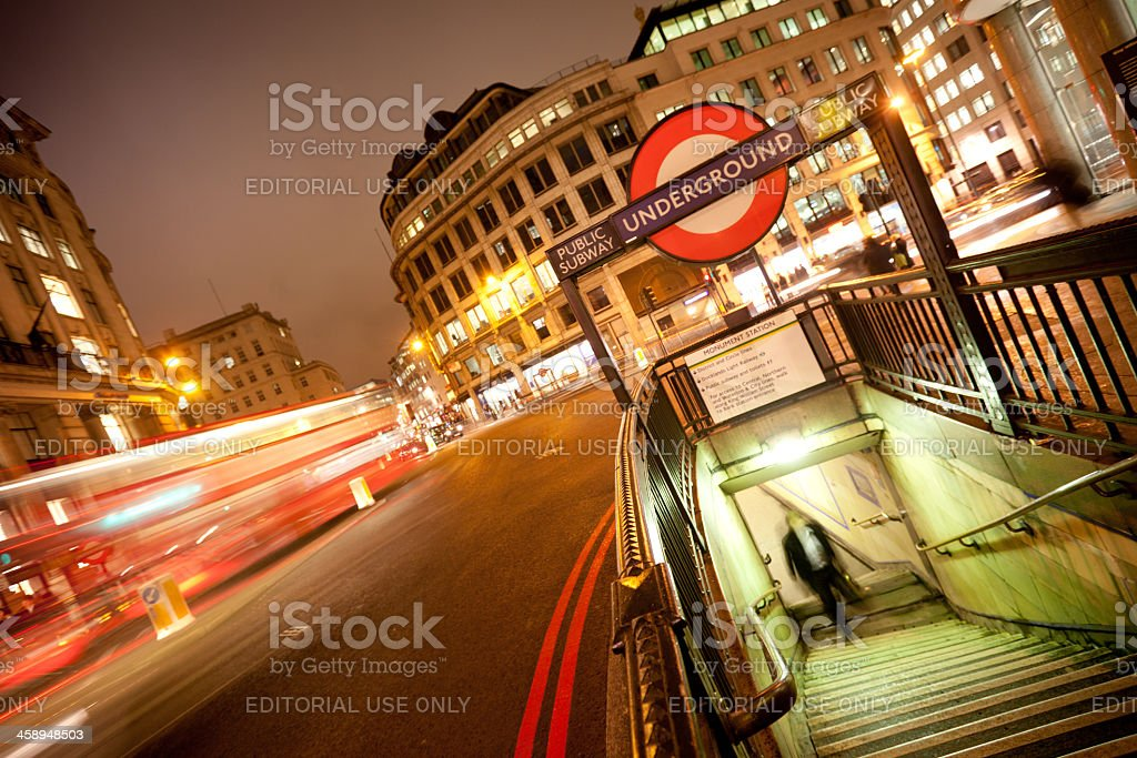 Underground sign and bus in London stock photo
