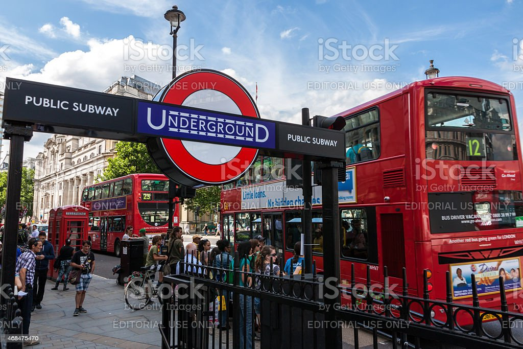 Underground stop and Red Bus in Trafalgar Square stock photo