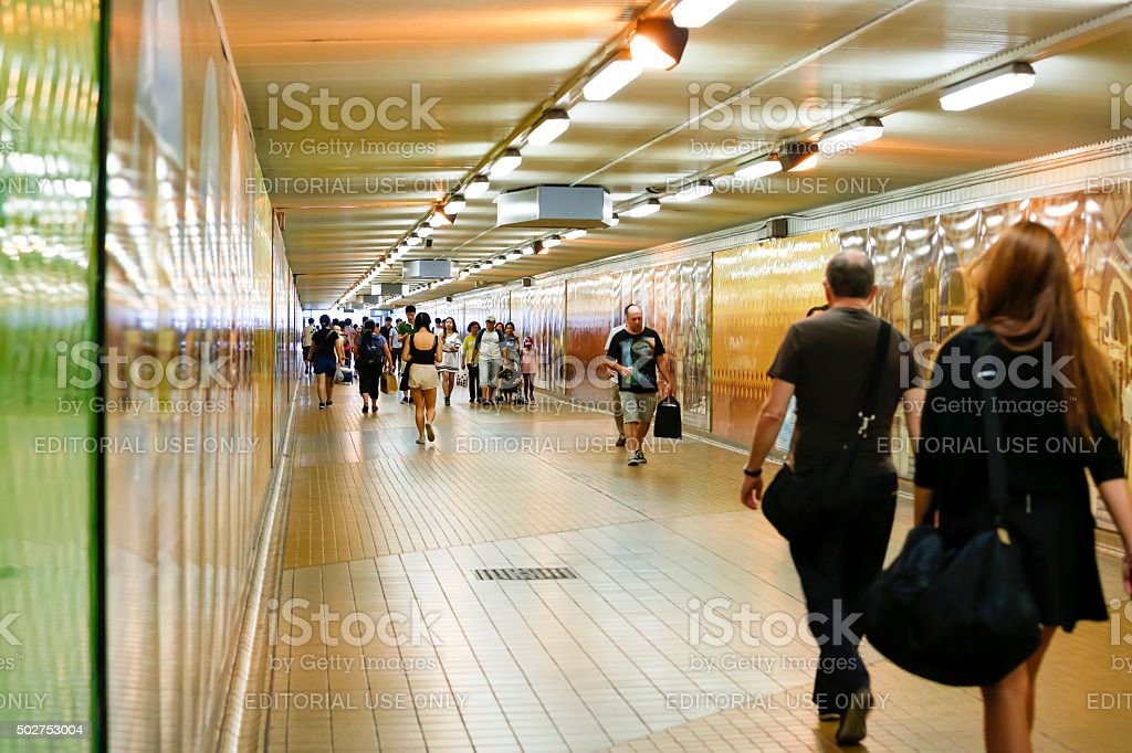 Underground subway in rush hour with passengers and travellers stock photo