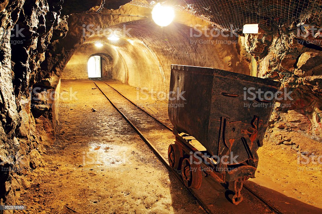 Underground train in mine, carts in gold, silver and copper mine. stock photo
