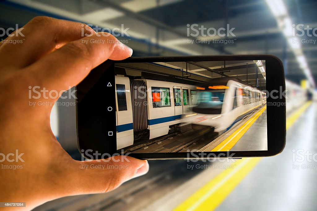 Underground train on mobile phone stock photo