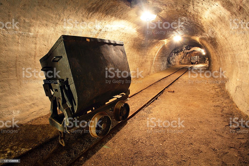 Underground train with carts in gold silver and copper mine royalty-free stock photo