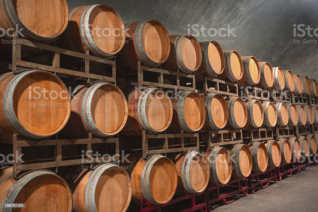 Underground Wine Cellar with wooden barrels royalty-free stock photo