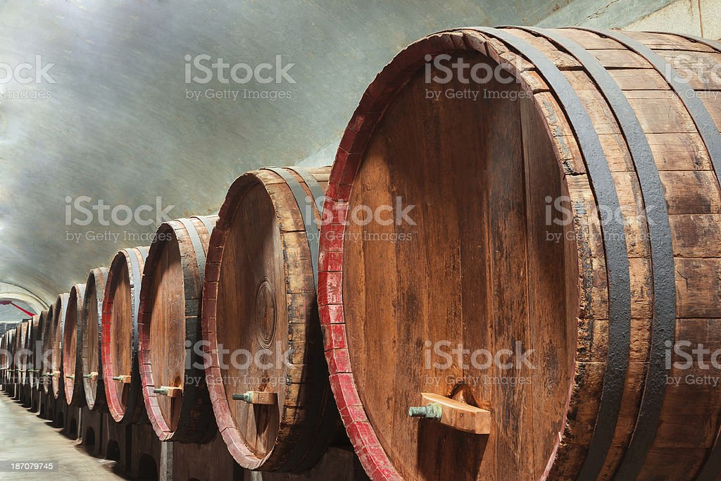 Underground Wine Cellar with wooden barrels royalty-free stock photo