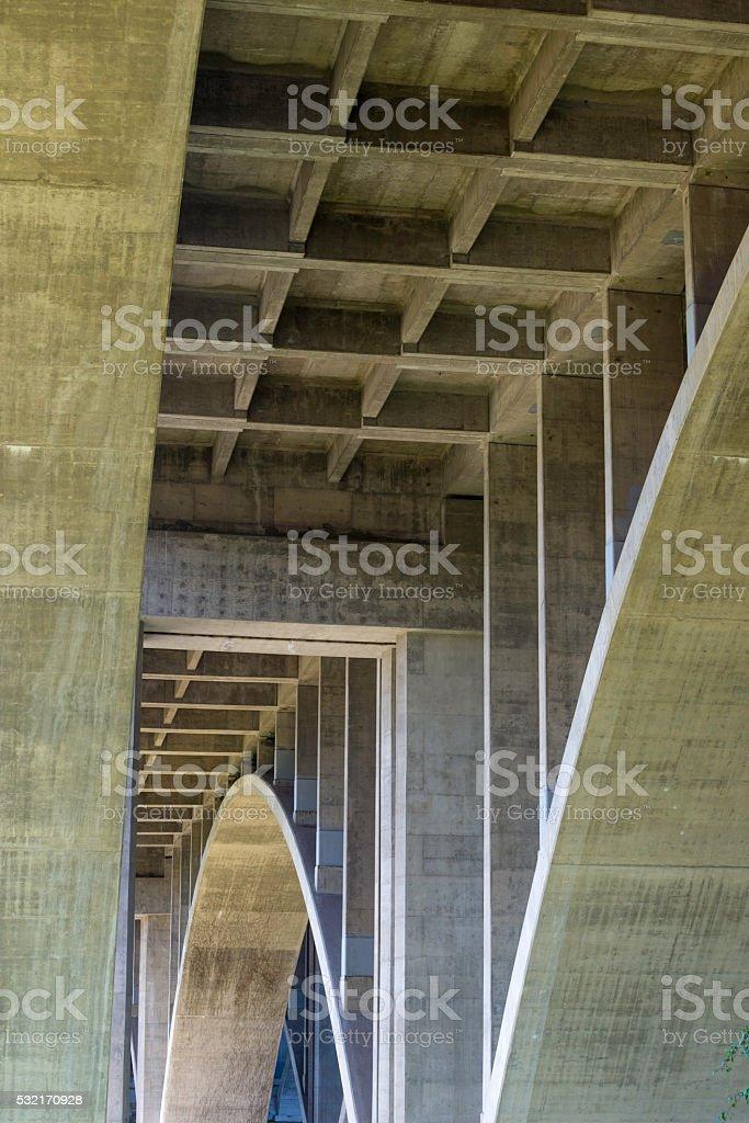 Underneath a concrete bridge stock photo