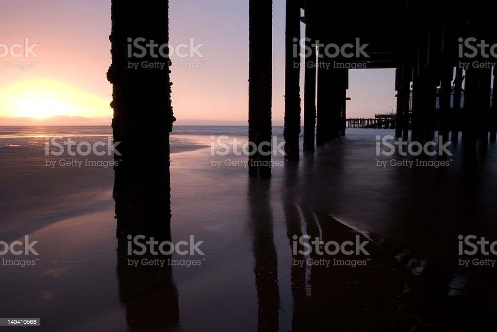 Underneath Clacton Pier in Essex, UK, at sunrise royalty-free stock photo