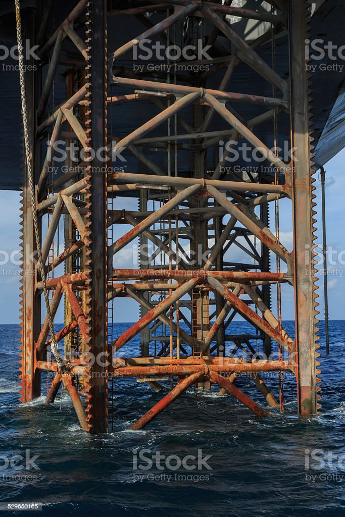 Underneath Jack Up Drilling Rig In The Ocean stock photo