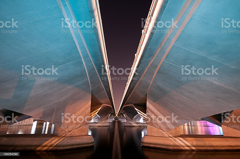 Underneath of bridge by night showing perspective and blue light stock photo