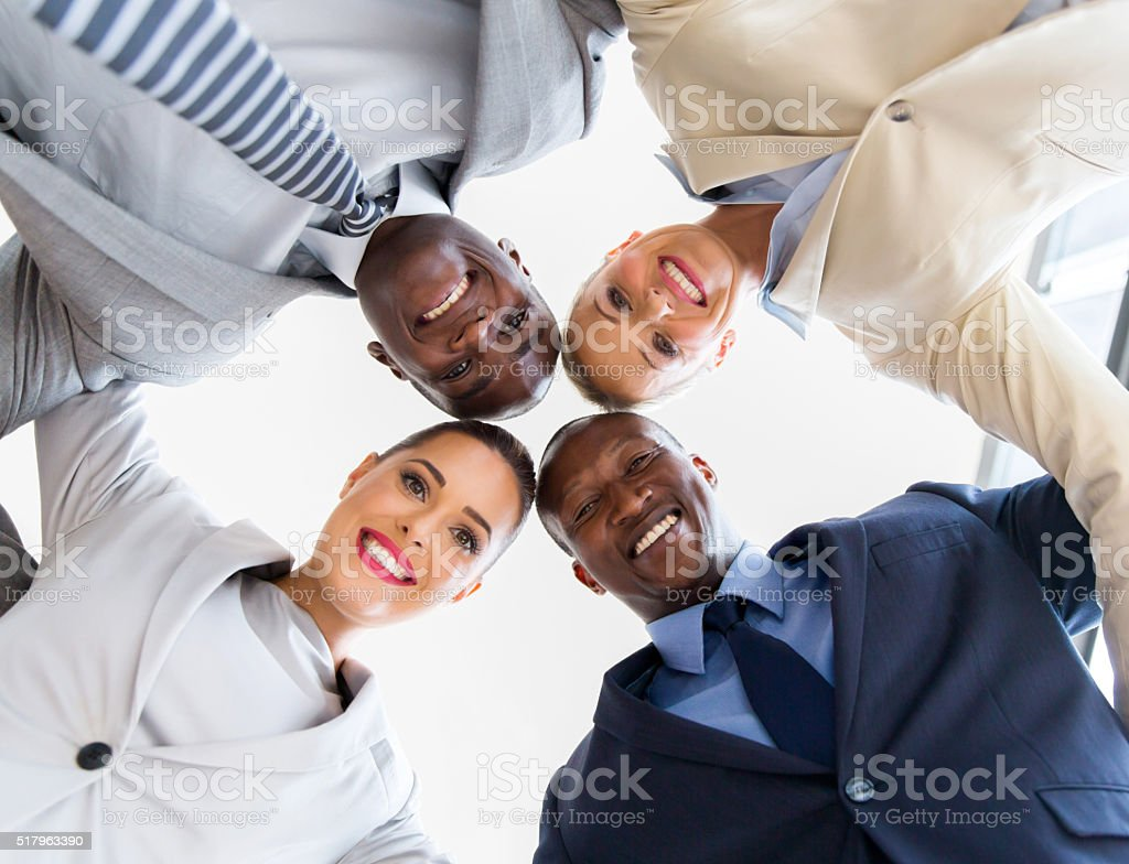 underneath view of business team looking down stock photo