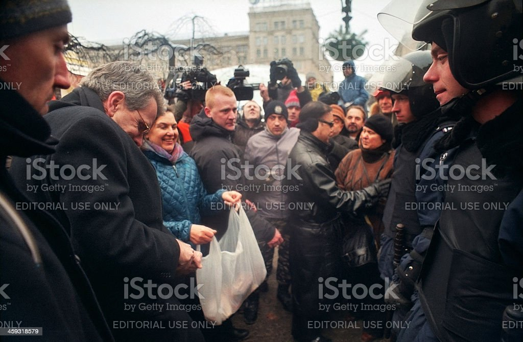 U.S. Undersecretary of State distributes food on Independence stock photo
