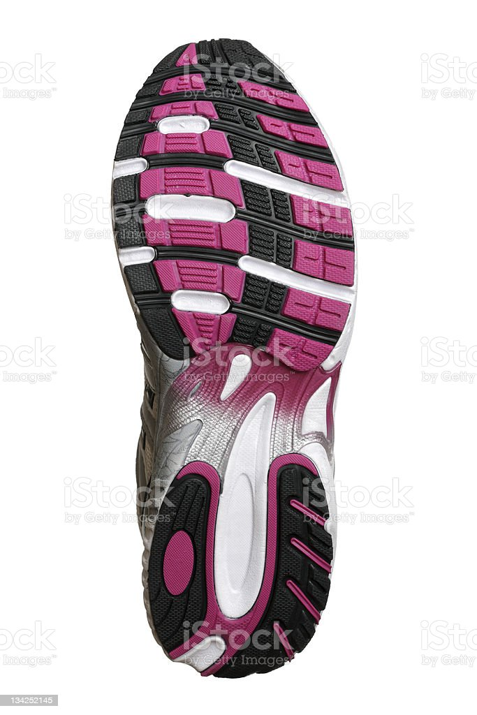 Underside of pink and black running shoe stock photo