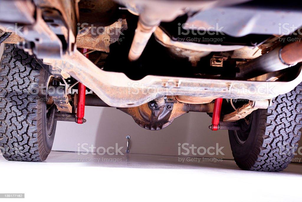 Underside of vehicle in garage. royalty-free stock photo