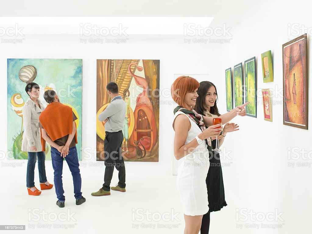 understanding art at exhibition opening stock photo