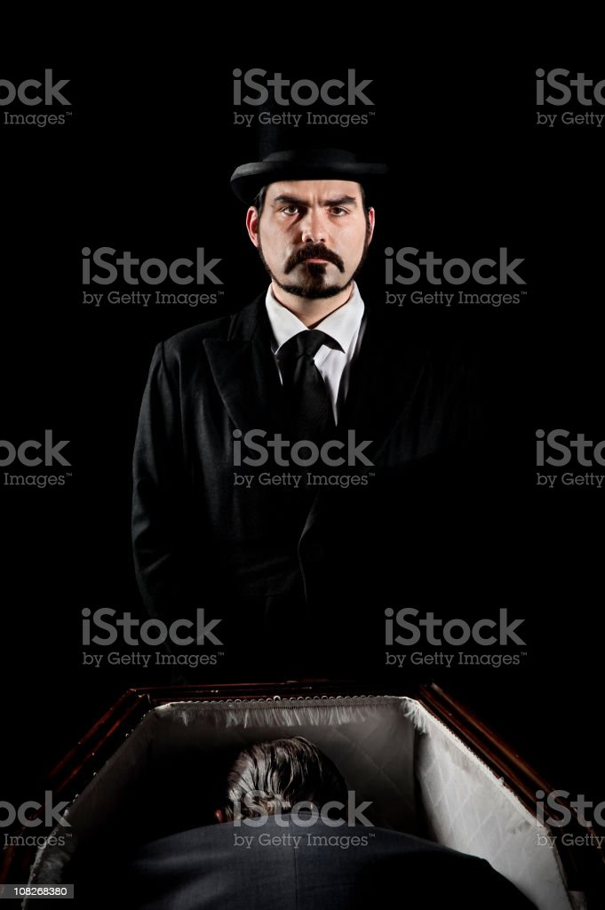 Undertaker and dead in a coffin stock photo