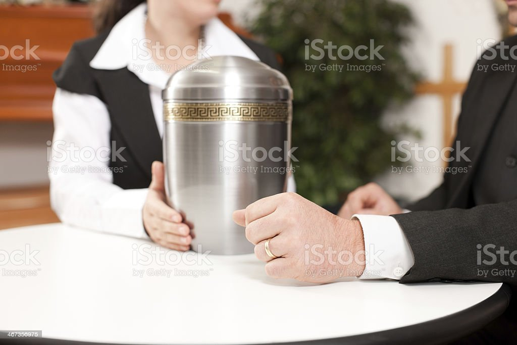 Undertaker is advising a client for the funeral stock photo