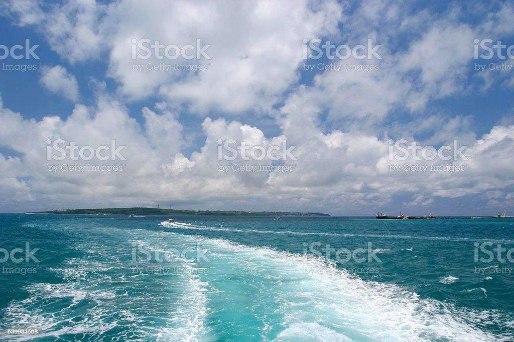 Undertow and tropical sky at Ishigaki island stock photo